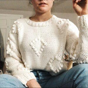 white pom pom sweater